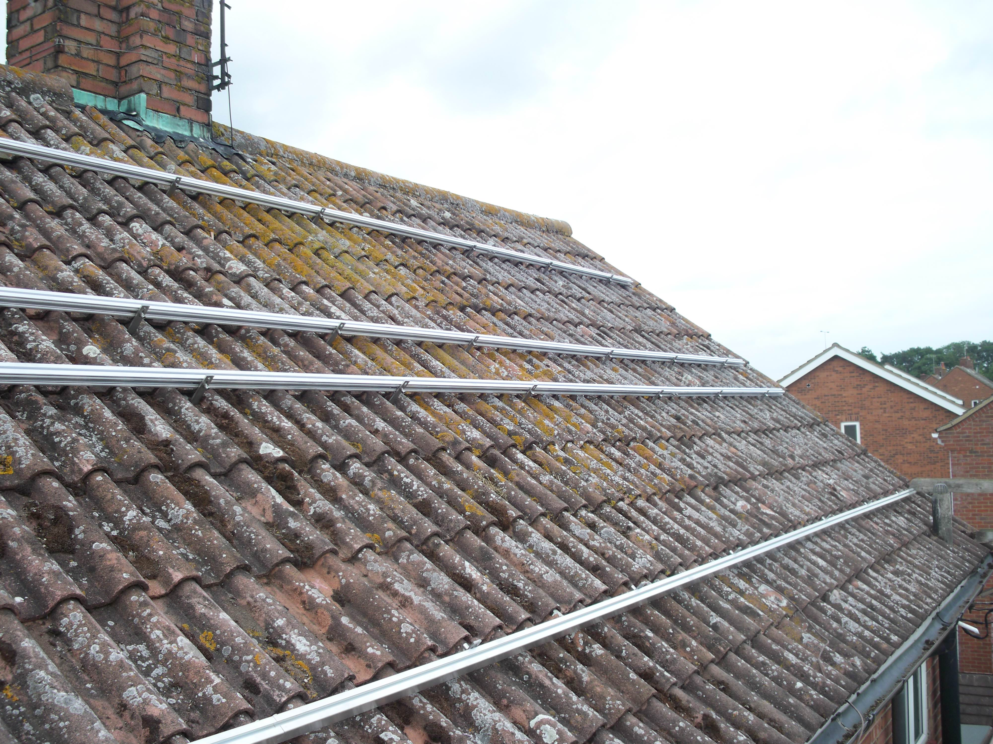 Solar Panels being fitted to a house in Huntingdon