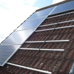 Solar PV Panels being fitted to roof in Alconbury